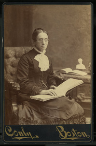 Laura Bridgman reading an embossed book