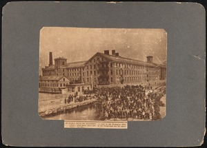 Wamsutta Mills with mill workers standing outside in foreground, New Bedford, MA
