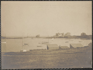 Shoreline with boats, buildings and possibly a hotel