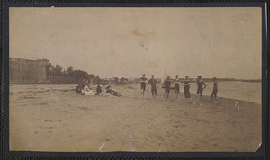 Bathers at Bass River, South Yarmouth, Mass. with bathhouses at left