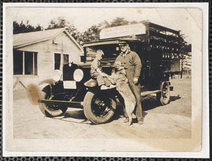 Alton F. Dunbar, driver for Drew's Auto Express, at Frank Tripp's house with a little boy and dog by the truck