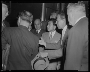 Crown Prince Akihito talking with a group of men