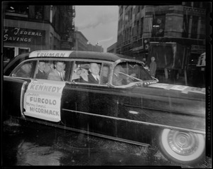 Harry Truman, John F. Kennedy, Foster Furcolo, and Edward McCormack seated in car with their names on the hood and side