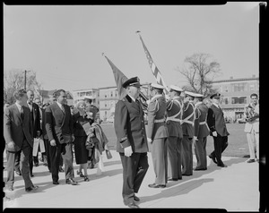 Vice President Richard Nixon walking with Congresswoman Edith N. Rogers toward color guard, students at the Lowell Tech Institute, where Nixon received honorary degree