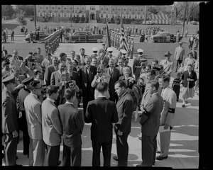 Vice President Richard Nixon, lower right, chats with members of the Lowell Tech Institute's Student Council upon arrival at the school today. In the background are state local dignitaries with school honor guard