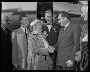 Vice President Richard Nixon shaking hands with U.S. Representative Edith N. Rogers in front of plane with Governor Chris Herter and others looking on