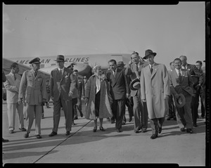 Vice President Richard Nixon and U.S. Representative Edith N. Rogers walking away from American Airlines plane with group