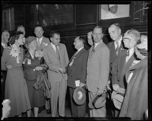 Vice presidential candidate Richard Nixon shaking hands with man, while Pat Nixon, Edith Nourse Rogers, Henry Cabot Lodge, Jr. and others look on