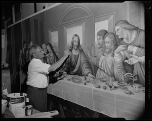 Gaston Goyette of Bedford, world-famous ecclesiastical artist, puts finishing touches to his interpretation of The Last Supper...a mural which will be part of the decorative scheme of St. Peter's Church, Worcester. It measures 24 feet in length and took five months to complete