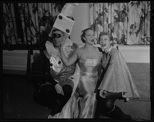 Hollywood TV-film star Denise Darcel, center, reigned as Queen of the Ball at the second Beaux Arts Ball sponsored by friends of School of Creative Arts of Brandeis University, at Hotel Somerset. Sumner Gerstein, left, and Hortense Lappin, co-chairmen, flank the star