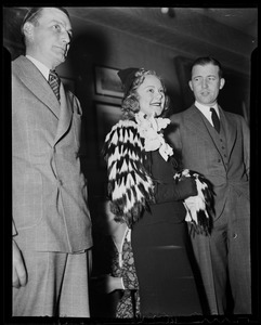 Sonja Henie at party with two men