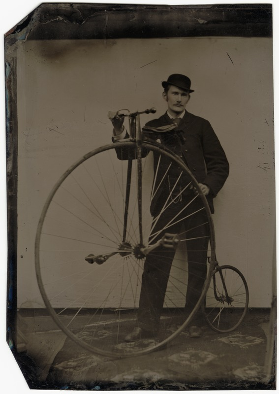 Cyclist with High Wheeled Bicycle