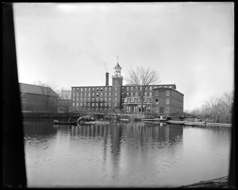 Front of mill from bolt. N.H. Hutchins in boat