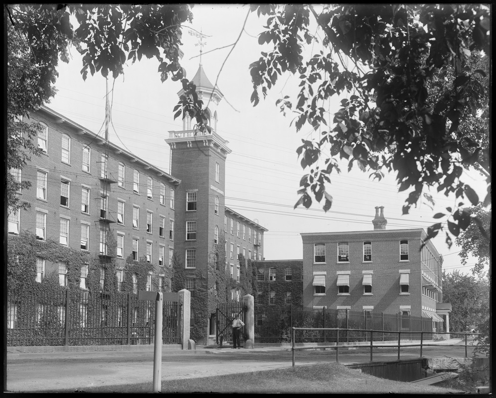 Front of mill from in front of #7 storehouse, L. Simpson at gate
