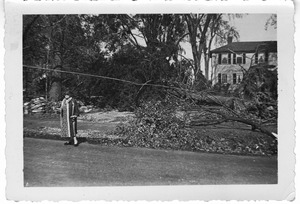 Ms. Buelah Sumner outside her house at 89 West Main Street after the 1938 hurricane