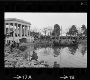Crowd on waters edge by the Plymouth Rock monument to watch re-enactment of the landing of the Pilgrims