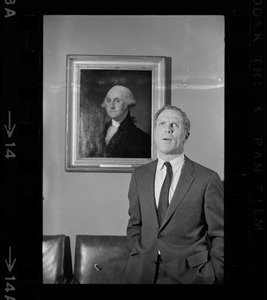 Mayor of Boston Kevin White standing in front of a Gilbert Stuart portrait of George Washington