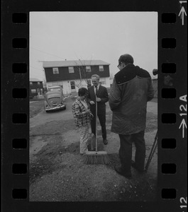 After White explained that the city would not provide municipal services unless the federal government - which has bought several homes in the area - will foot the bill, the women offered him a broom to help clean up the streets