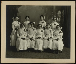 Group portrait of women dressed in white