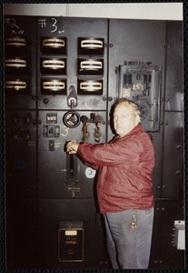 Lower Pacific Mills. Jim McGregor, maintenance man (36 yrs employed) at main power switch to #3 generator