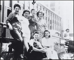 A group of mill girls were taking a lunch break in front of the Pacific Mills Lawrence, MA, 1943