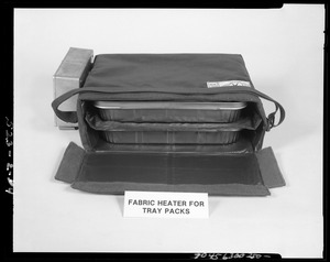 Fabric heater for tray packs