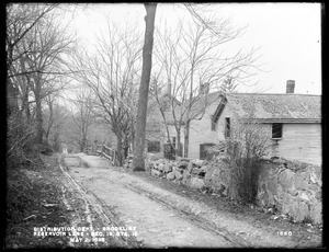 Distribution Department, Southern High Service Pipe Line, Section 19, Reservoir Lane, station 15+; William D. White's two houses and John J. Mooney's house, on the north side of lane, from the southeast, Brookline, Mass., May 2, 1898