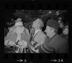 Boston Mayor Kevin White and Santa Claus at Christmas decoration lighting ceremony on Paul Revere Mall